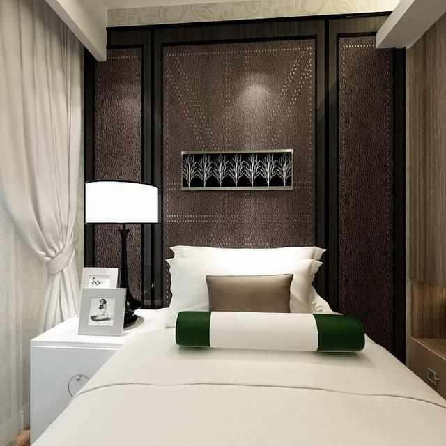 港式主卧同样使用软包床头背景墙,柜体和墙体都使用简单的线条和色彩图片