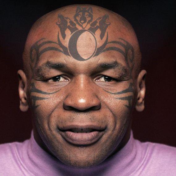拳王泰森的纹身有什么秘密?右手一条龙,左手纹着让的|图片