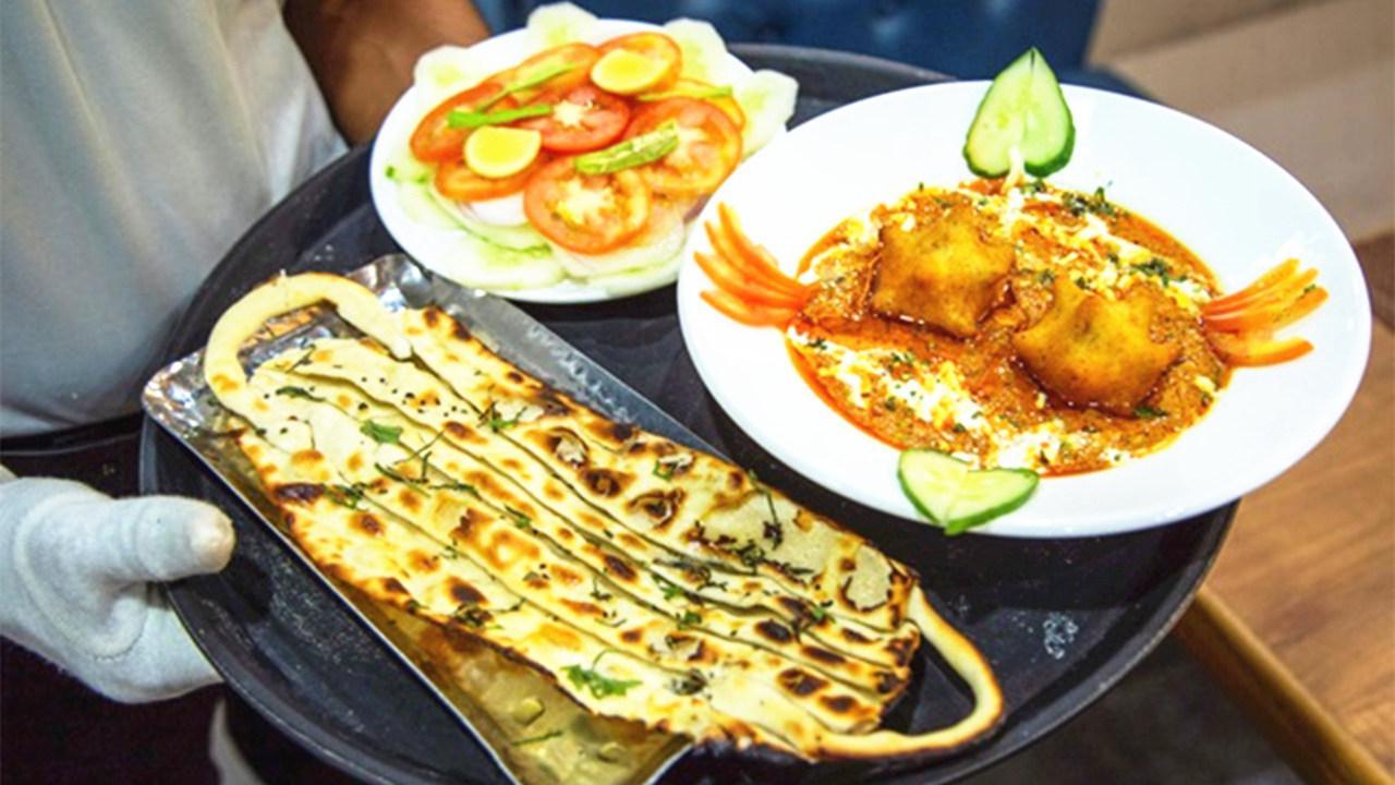 """别出心裁!印度餐馆为吸引顾客竟推出这种咖哩和""""口罩烤饼"""""""
