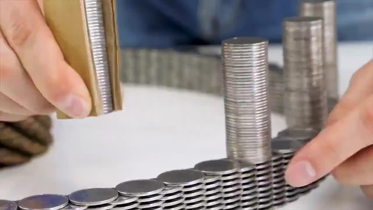 小伙用2万枚钱币,挑战搭建物体模型,结果会怎样能成功吗?