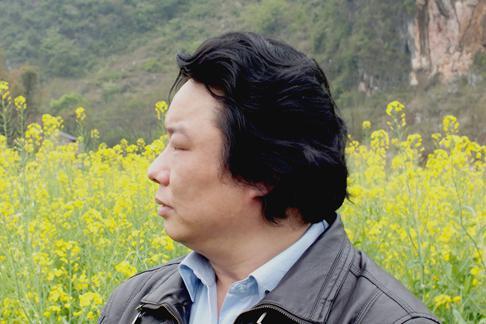 春洒遍地金——赏画家龙万和油菜花作品