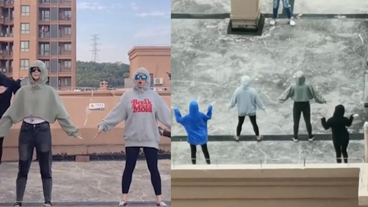 网友俯拍对面楼顶镜头越拉越近 有几名年轻男女在拍跳舞视频