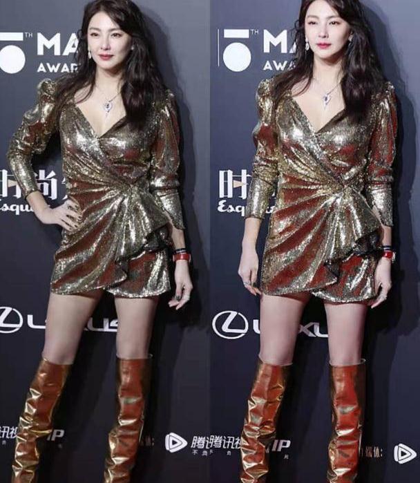 张雨绮身穿短裙加长筒靴,尽显迷人气质,一双长腿惹人羡慕