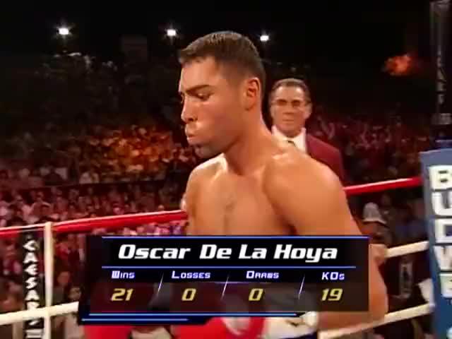 拳王德拉霍亚成名之战四回合将老查维兹打得面目全非