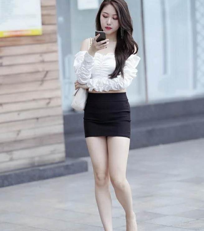 气质型美女,搭配黑色包臀裙,魅力强大