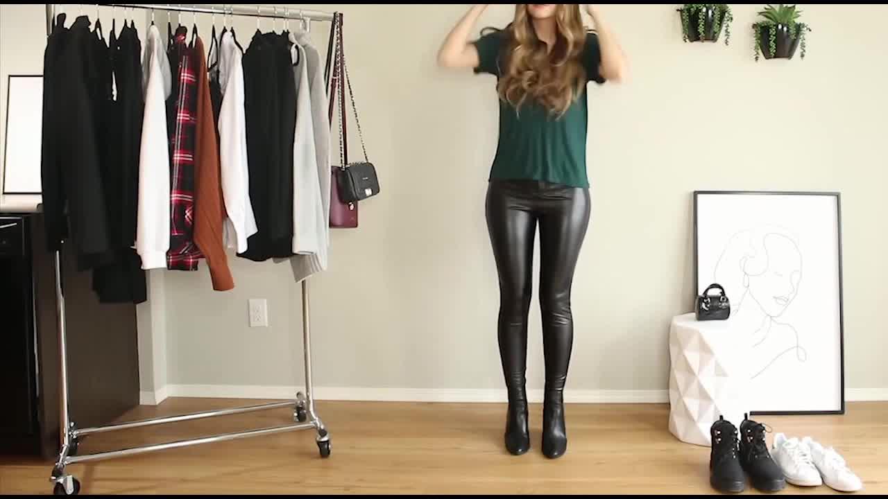 黑色上衣搭配亮面长裤,简约风格的时尚穿搭