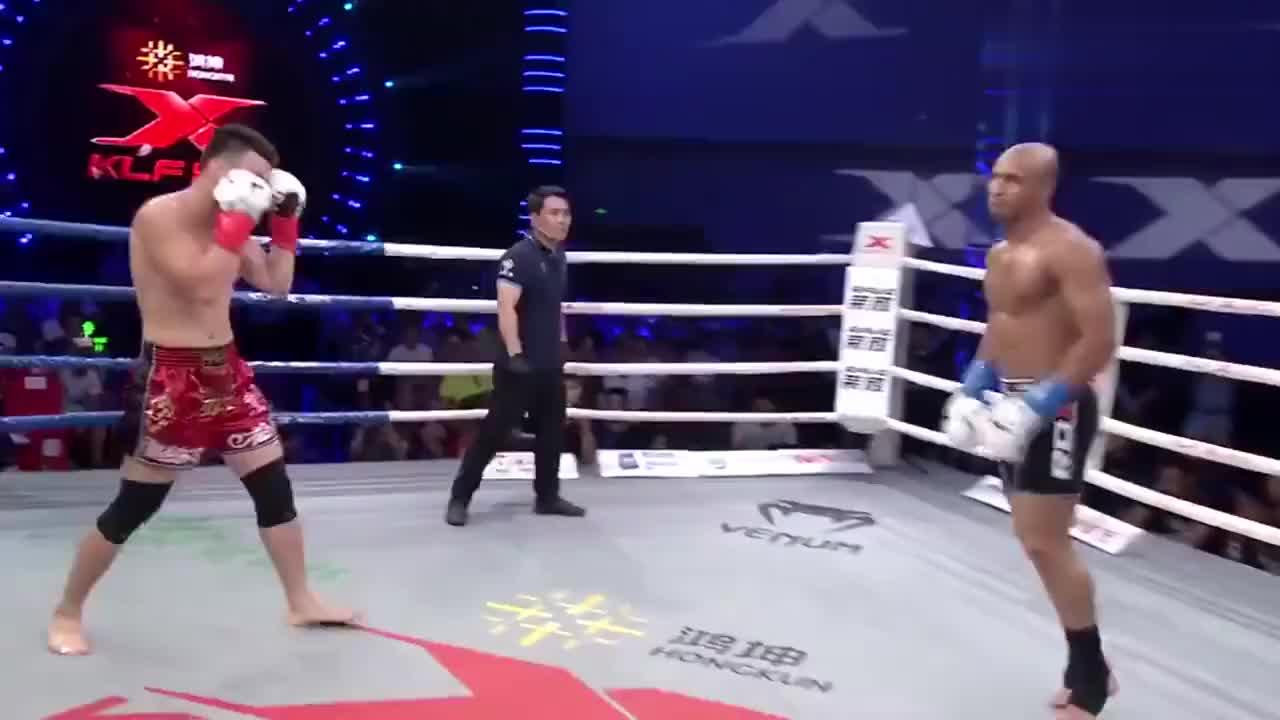 伊朗拳王飞身高扫猛踢头,名将孙扬一拳打休克劲敌口鼻流血KO获胜