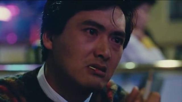 英雄本色:狄龙的白风衣,周润发的黑墨镜,堪称香港电影经典一幕