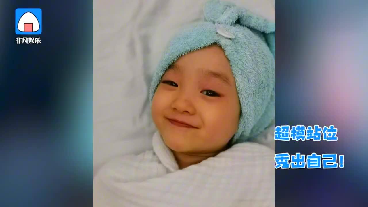 杨威分享双胞胎女儿萌照 直呼:让哥哥带你们成团!