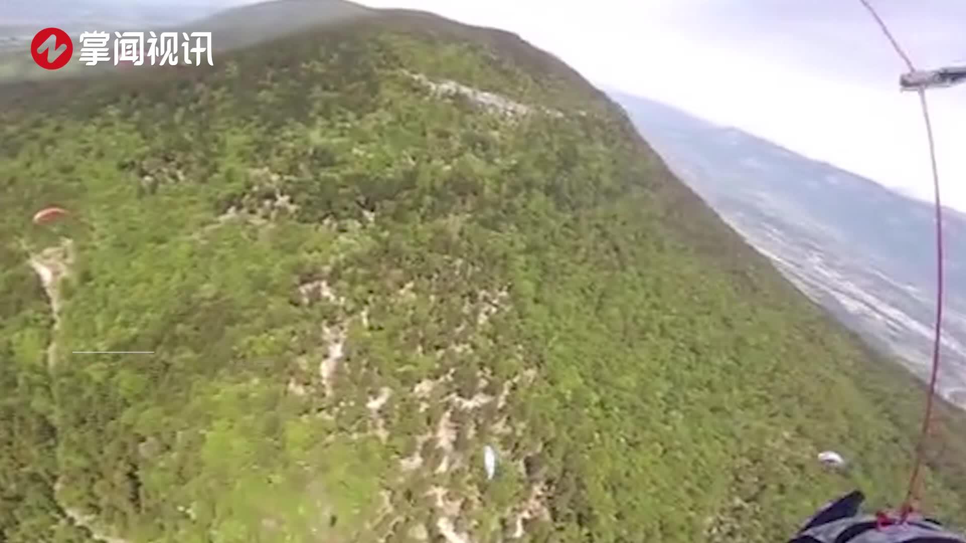 高空惊险一幕!两名滑翔伞运动员空中相撞缠绕坠落死里逃生