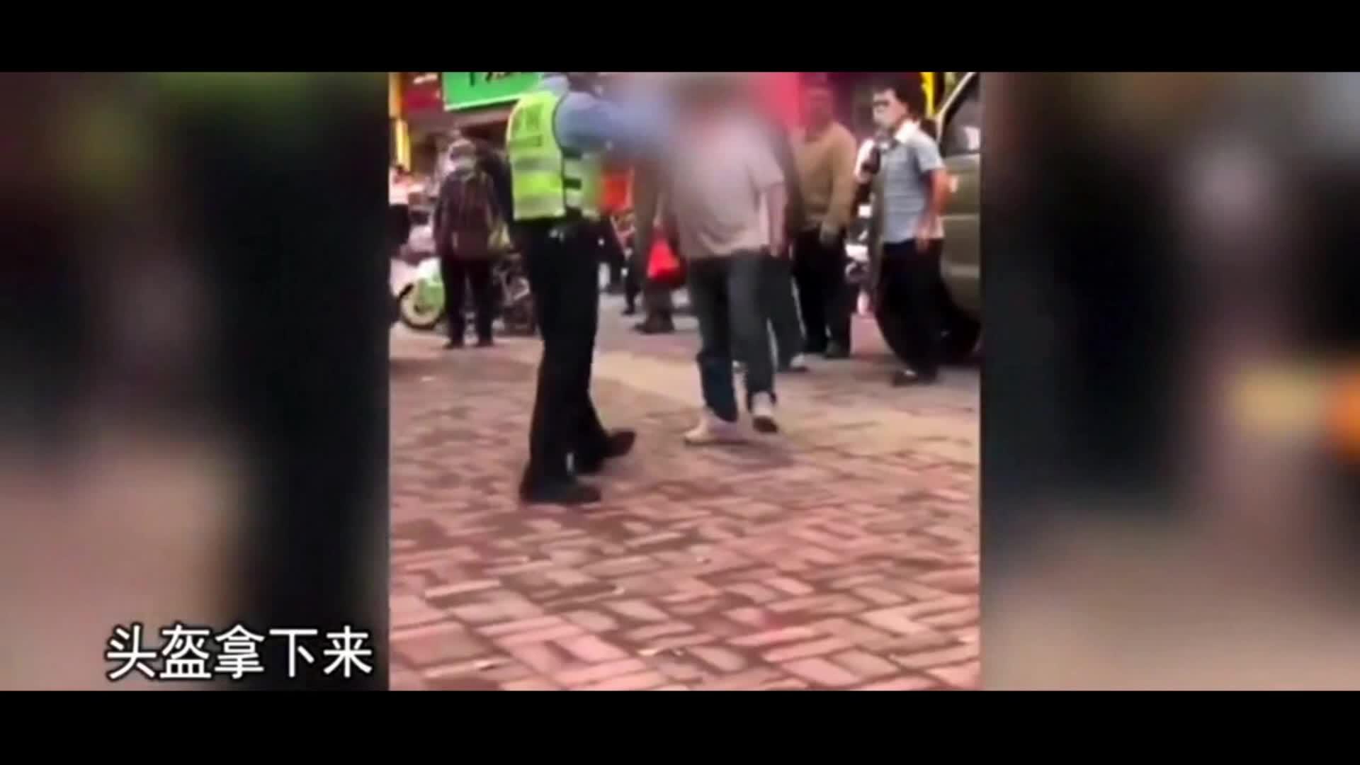 遮挡号牌被拦下男子暴力抗法还朝民警吐口水