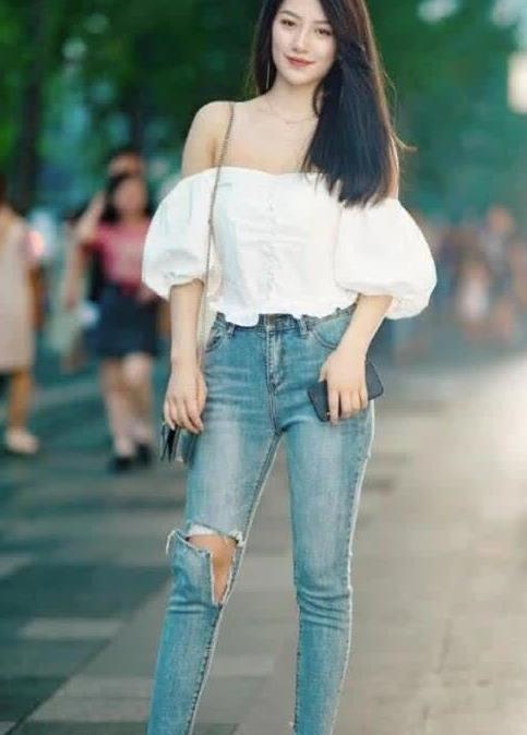 街拍:高挑的身材,绝佳的气质,搭配牛仔裤便是最好的搭配