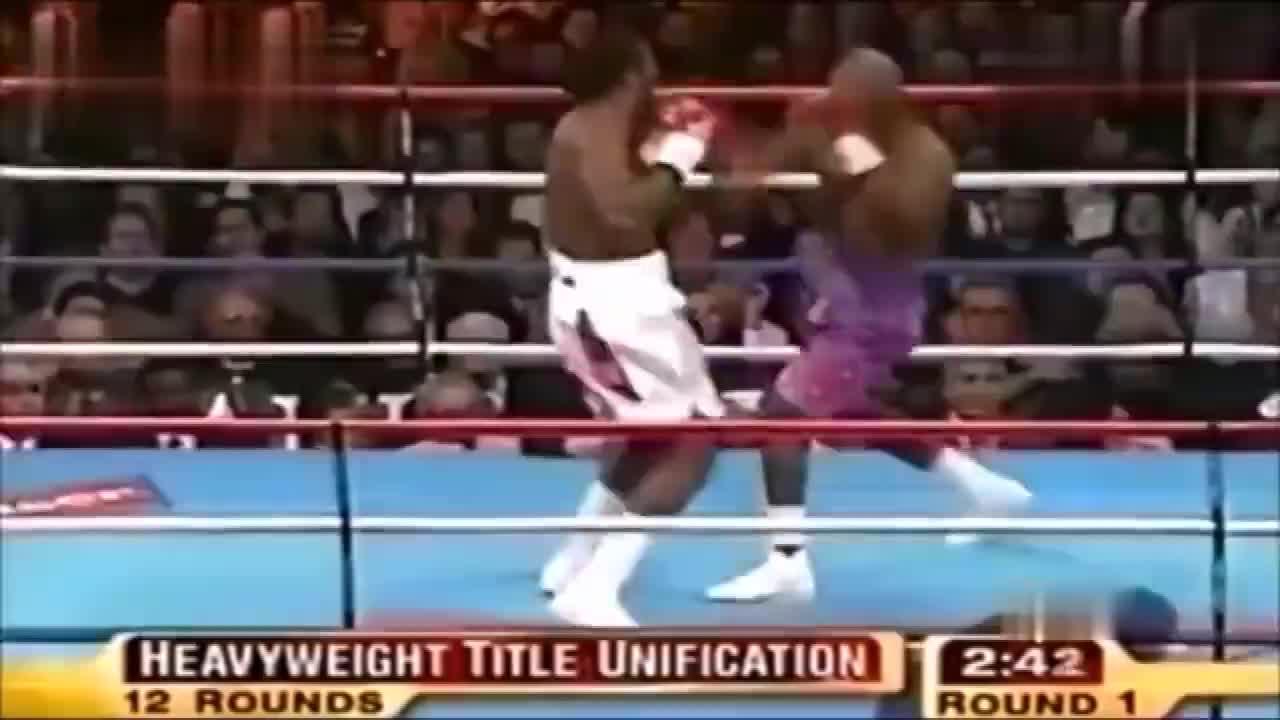 早期拳坛经典一战,刘易斯二番战击败霍利菲尔德,彻底统一重量级