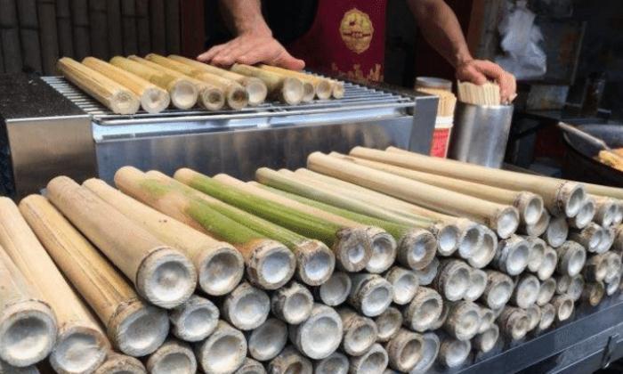 """大娘街边卖""""甘蔗"""",5元一根,吃完不用吐渣,顾客:一次吃十根"""