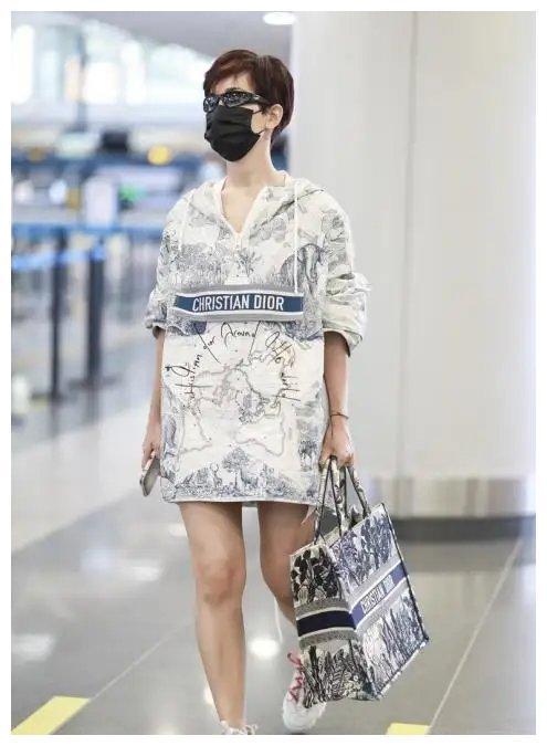 韩庚老婆备孕?35岁卢靖珊独现机场,手臂腿部粗壮身材走样太抢镜