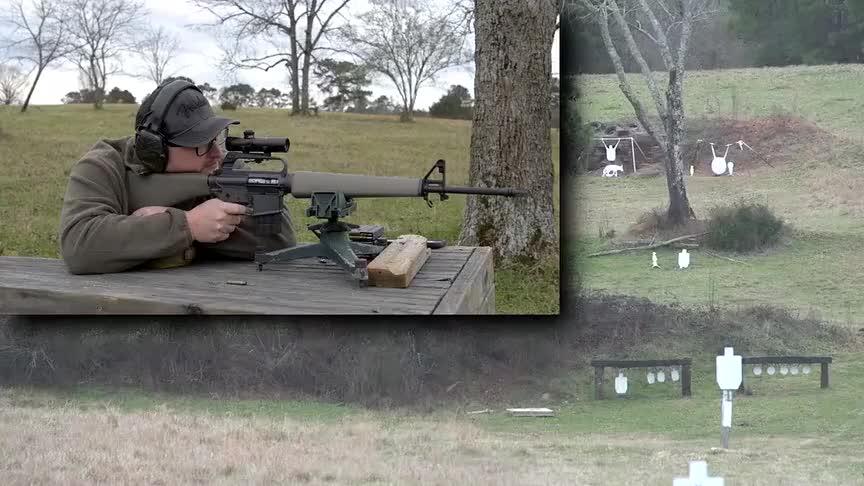 配备瞄准镜的自动步枪,户外打靶测试,枪法很准