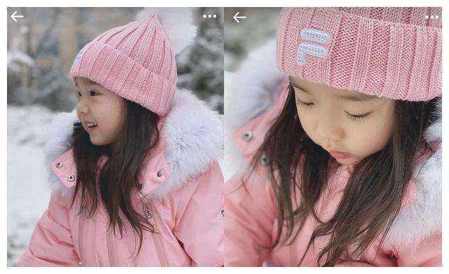董璇晒女儿玩雪,小酒窝穿一身粉色呆萌像天使,长睫毛跟爸爸一样