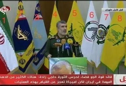 伊朗革命卫队司令身后的旗帜大多是中东极端组织的