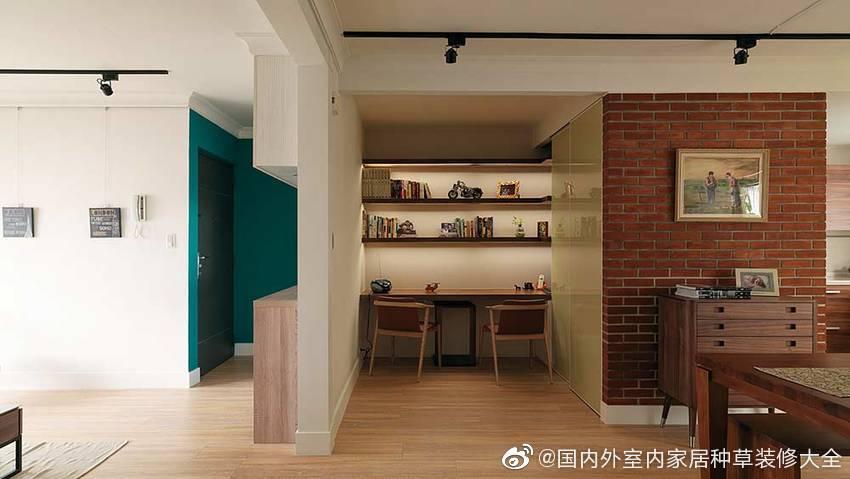 鞋柜也是一面隔断墙,将这个本就不大的空间分割出一个学习区域