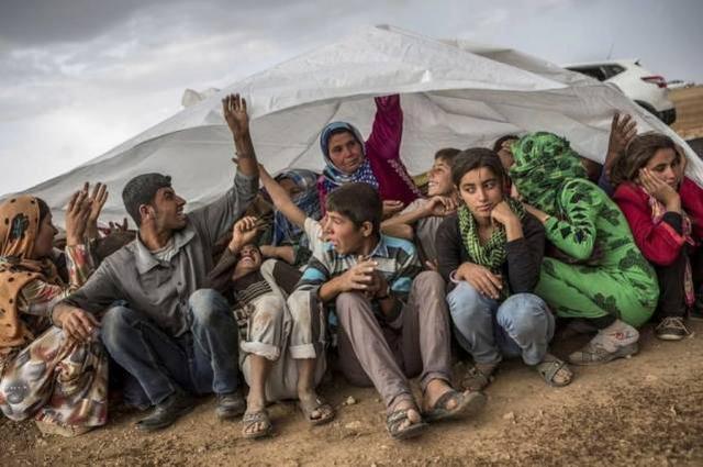 土耳其2000辆卡车越境为130万难民送粮联合国高度称赞