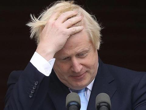 """约翰逊成""""群体免疫""""牺牲品,英国应追究提出者的责任"""