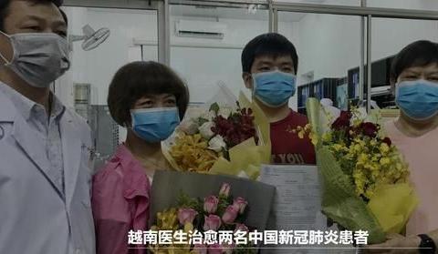 越南-中国共同抗击新冠肺炎:在胡伯伯画像下展示携手胜利的信心