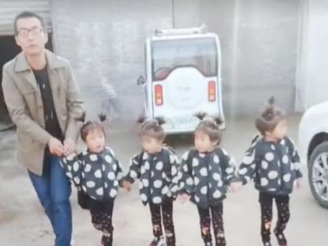 爸爸送四胞胎女儿上学,场面很温馨,网友:上辈子拯救了银河系?