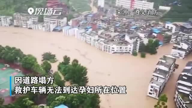踏过泥泞路 走过塌方区 他们救出洪灾中被困的出血孕妇