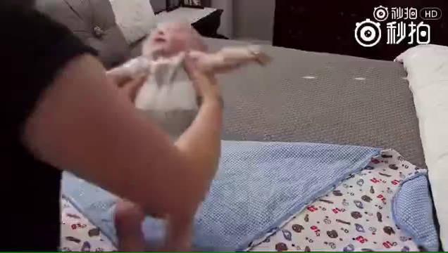 新爸新妈学起来:如何把宝宝包裹得舒舒服服