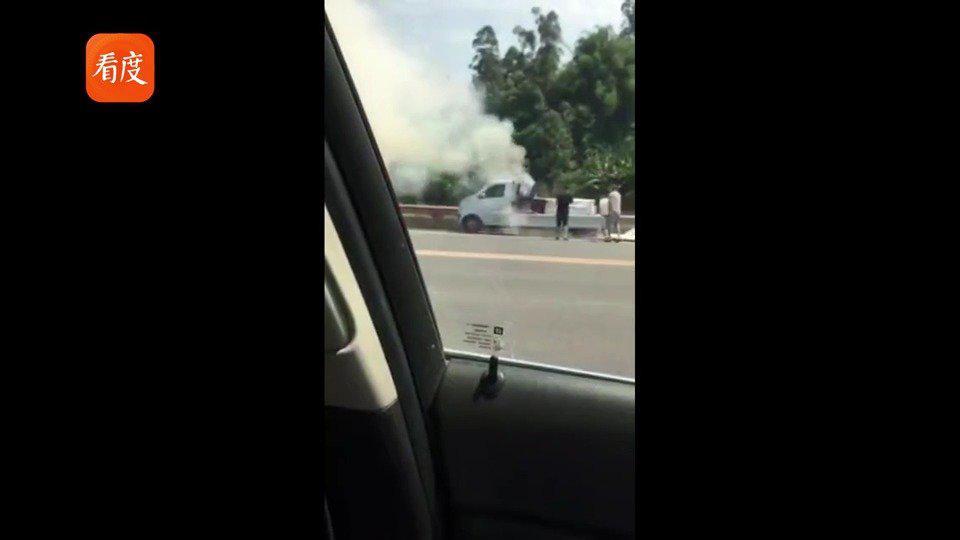 正能量!偶遇货车起火 夫妻俩一人报警一人帮忙灭火!
