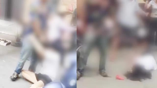 女子当街被暴打事发广东 警方:与男子系夫妻关系 离家出走多年被