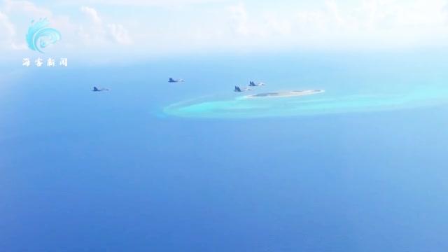 现场!解放军苏-30战机长途奔袭10小时 挂弹巡航南海岛礁画面曝光