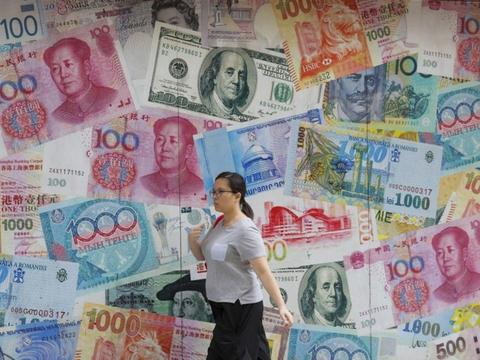 中国将免除12种货币之间的交易费 避开美元以提振人民币