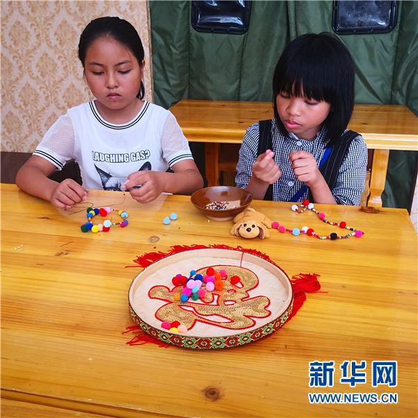 """""""这里比'老家'好玩""""——贵州六枝特区搬迁小区暑期生活见闻"""