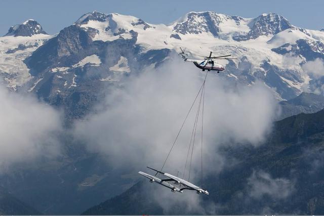 俄争夺北极新利器,最庞大直升机米26,不惧严寒向北方挺进