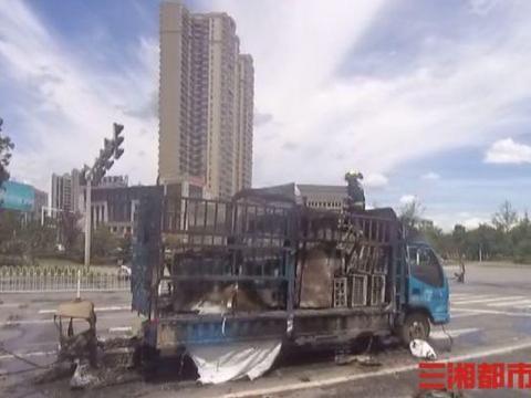 岳阳一货车路口自燃,洒水车客串消防车紧急灭火