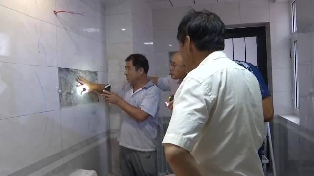 2、施工方:水泥标号太高 瓷砖出现裂纹 潍坊市小区施工方工作人