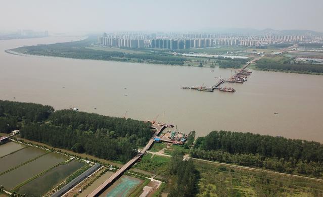 江苏在建的一座跨江大桥,主跨长度1092米,负载量达到世界之最