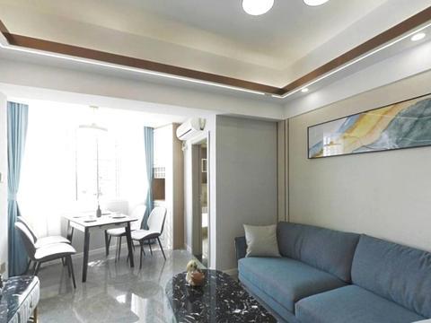 50㎡小蜗居,客厅阳台改造成餐厅,卧室抬高10cm设计成地台