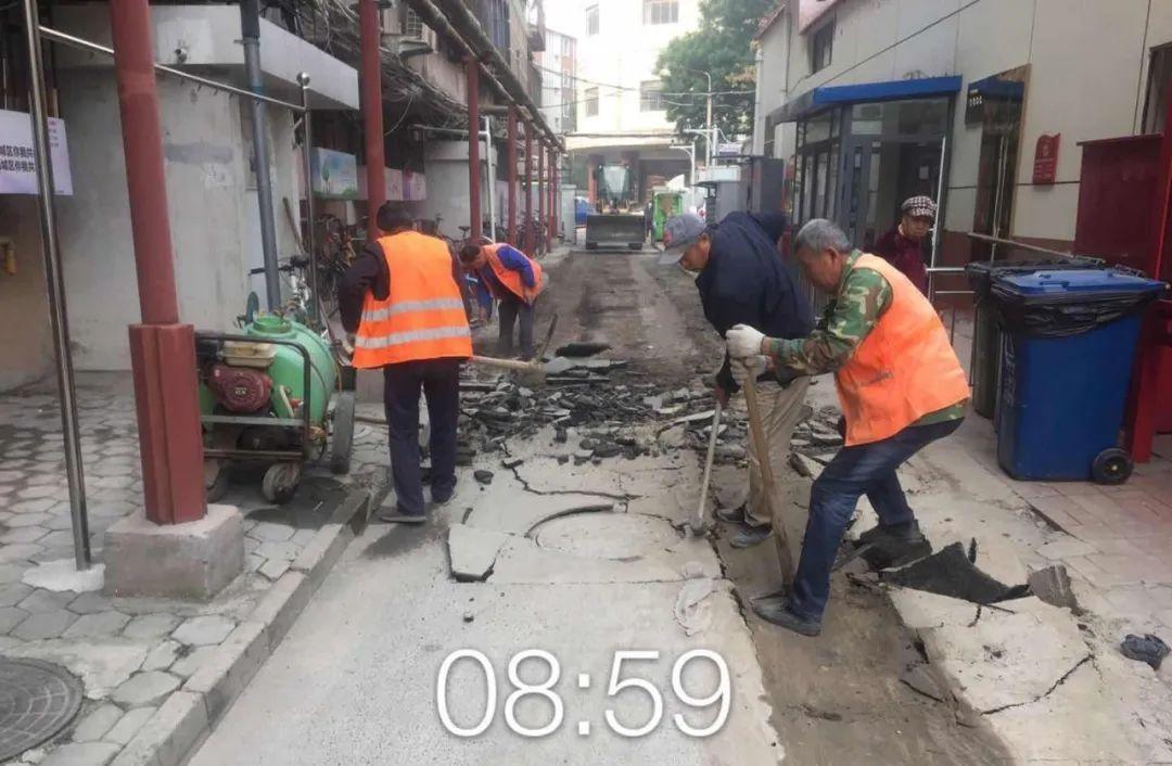 道路里巷养管一所积极实施南华里路面恢复工程