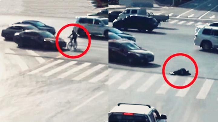 """实拍:骑车者无视车流""""勇""""闯红灯被撞 转体360度猛摔负全责!"""