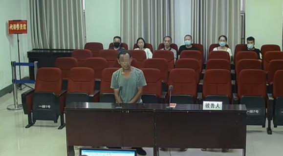 2020年8月19日,刘广聚在一审法庭上。图片来源:中国庭审公开网庭审录像截图。