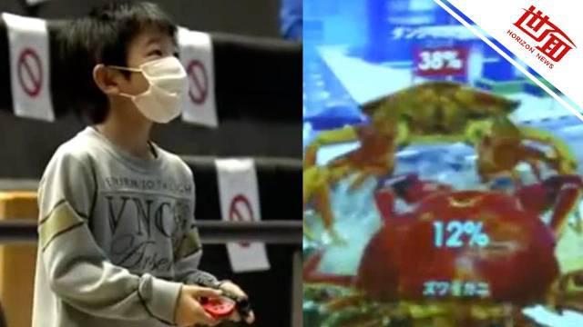 日本举办操控螃蟹电竞比赛 赢家吃真螃蟹
