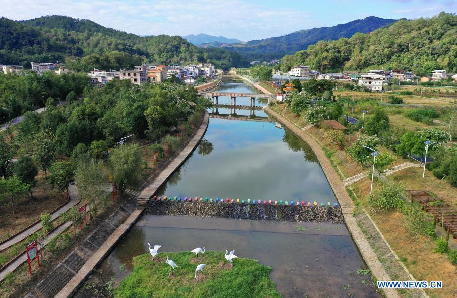 Aerial photo taken on Nov. 21, 2020 shows renovated river banks in Zhikeng Village, Xiyang Township of Meizhou City in south China's Guangdong Province. In recent years, Meizhou, hometown to many overseas Chinese, has stepped up with its efforts preserving ecological environment and improving living environment in the rural areas to boost village tourism. (Xinhua/Li He)