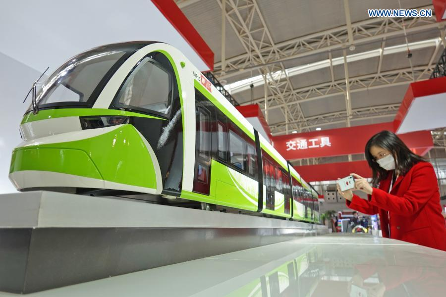 A visitor takes photos of an automatic tram model at an industrial design exhibition during the 2020 World Industrial Design Conference in Yantai, east China's Shandong Province, Nov. 25, 2020. The 2020 World Industrial Design Conference is held from Nov. 25 to 29 in Yantai. The conference also includes an exposition of China's top industrial designs, with over 800 domestic companies showcasing over 1,000 exhibits of new technology, new design and new products. (Photo by Tang Ke/Xinhua)