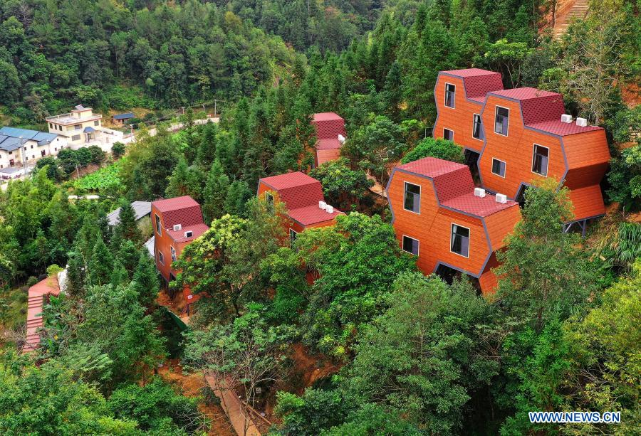 Aerial photo taken on Nov. 24, 2020 shows uniquely shaped homestay facilities in Dongling Village, Sanzhen Township of Meizhou City, in south China's Guangdong Province, Nov. 24, 2020. In recent years, Meizhou, hometown to many overseas Chinese, has stepped up with its efforts preserving ecological environment and improving living environment in the rural areas to boost village tourism. (Xinhua/Li He)