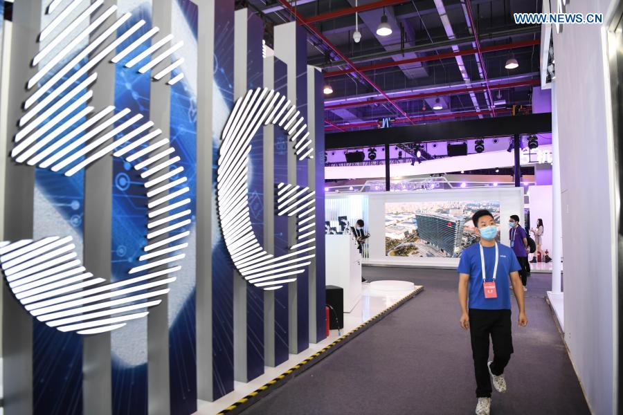 Photo taken on Nov. 26, 2020 shows a 5G-themed exhibition held during the World 5G Convention in Guangzhou, south China's Guangdong Province. The 2020 World 5G Convention kicked off in Guangzhou Thursday, during which world-renowned infocom scientists, 5G service providers and 5G application adopters will exchange ideas on aspects of cutting-edge technologies, industrial development trends and innovative applications in 5G industry. (Xinhua/Deng Hua)