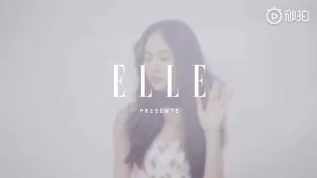 唐嫣登上《ELLE》12月刊封面,樱花粉色抹胸裙搭蝴蝶结缎带…………