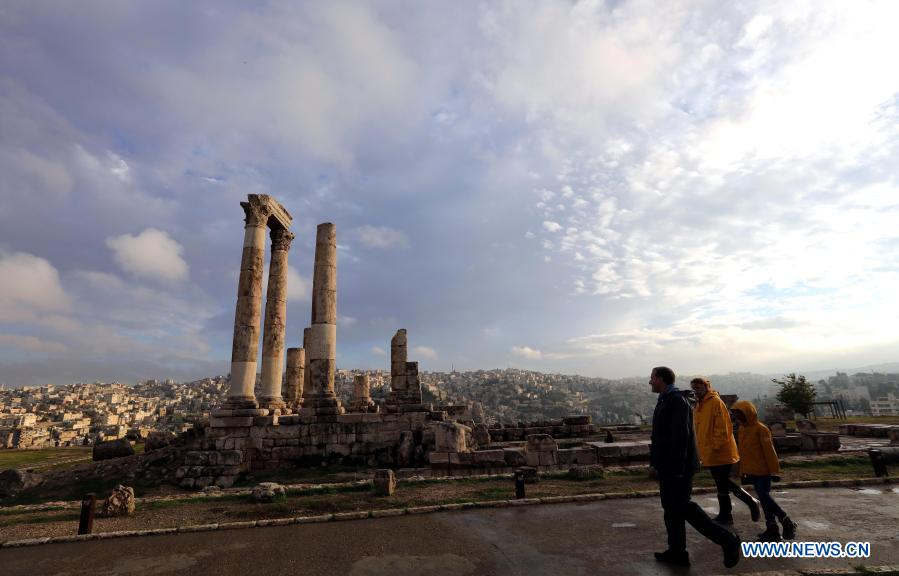 Tourists visit the Citadel archaeological site in Amman, capital of Jordan, Nov. 26, 2020. (Photo by Mohammad Abu Ghosh/Xinhua)