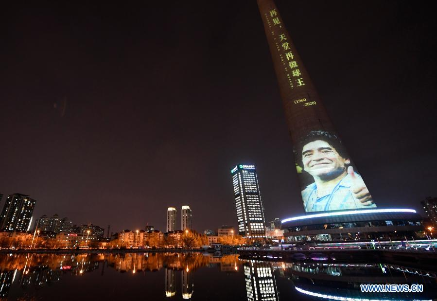The image of football legend Diego Maradona is projected on Tianjin TV Tower in north China's Tianjin Municipality, Nov. 26, 2020. Maradona died at the age of 60 on Wednesday of a heart attack. (Xinhua/Li Ran)